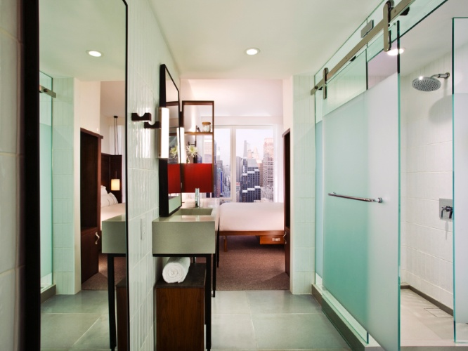 Guestrooms Maximize Natural Light With Frosted Glass Enclosed Rain Showers And Floor To Ceiling Windows. 4 of 8