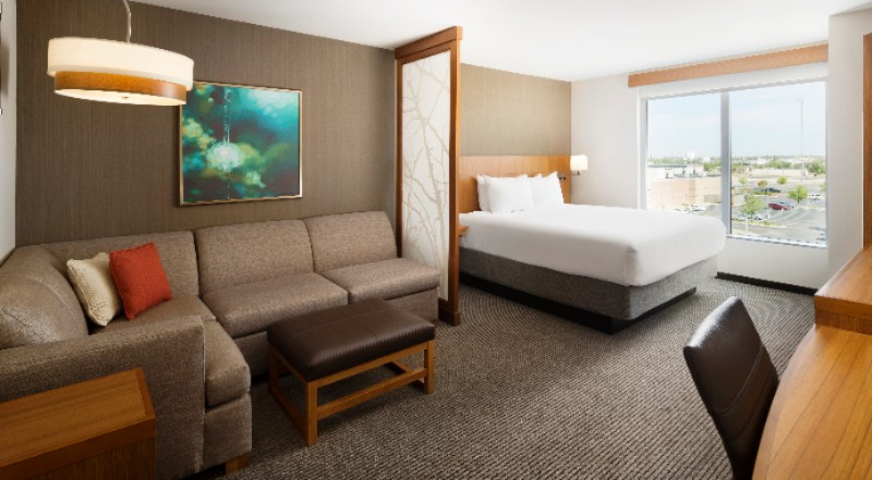 One Of Our Standard Rooms With A King Hyatt Grand Bed® And Our Cozy Corner With Sofa Sleeper 15 of 25