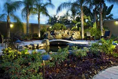 Relaxing Patio Area With Waterfall And Koi Fish Pond 4 of 9