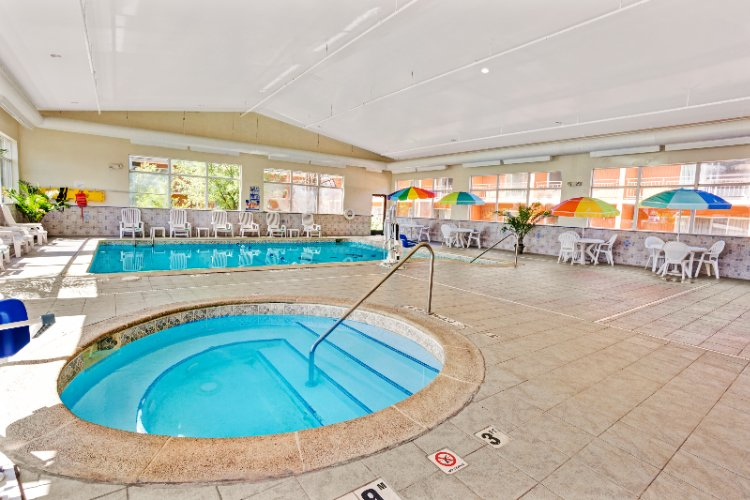 Your Key To Relaxation Our Lovely Pool & Jacuzzi Area 6 of 16