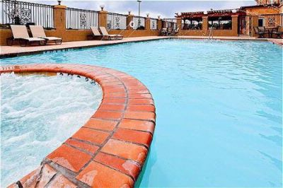 Swimming Pool & Hot Tub With Cascading Fountains 3 of 6