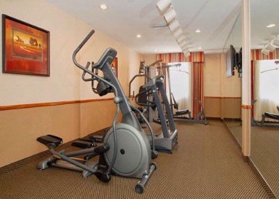 Fitness Room With Treadmill Eliptical And Multi Station Weight System 11 of 14