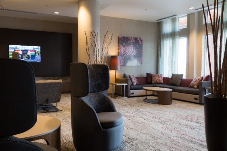 Living Space With Ample Charging Stations Lets You Socialize And Stay Connected. 12 of 13