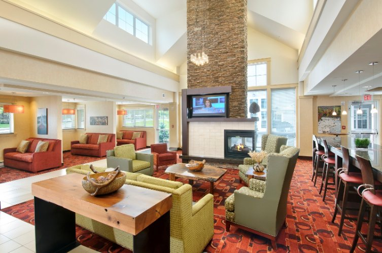 Our Lobby Area Features Multiple Flat Screen Tv\'s And A Fireplace 5 of 10