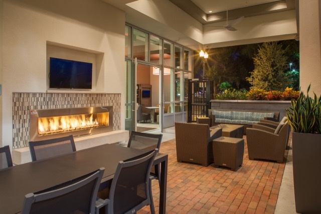 Relax Around The Fireplace In Our Spacious Outdoor Patio 3 of 20