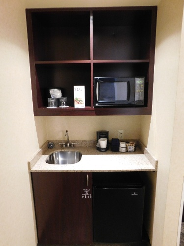 Wet Bar Area With Coffee Maker Microvawe And Mini Fridge 7 of 13