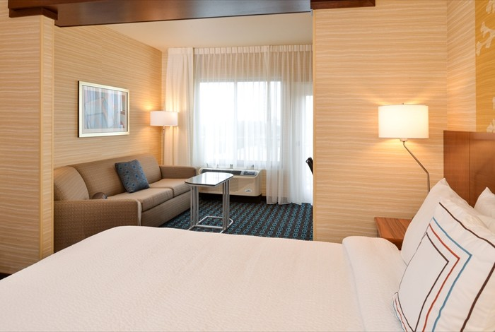 Hotel Suite Featuring Separate Living And Sleeping Areas Free High Speed Internet Microwave And Refrigerator 14 of 16
