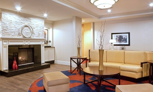 Lobby Features Inviting Fireplace And Overstuffed Chairs 8 of 23