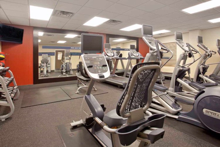 Take Advantage Of Our Modern Fitness Center With State-Of-The-Art Equipment And A Flat Screen Tv To Make Your Work Out Fly-By! 10 of 15