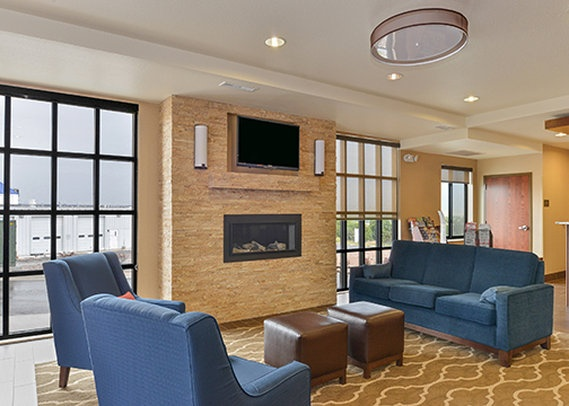 Bright Lobby With Tv And Fireplace 4 of 7