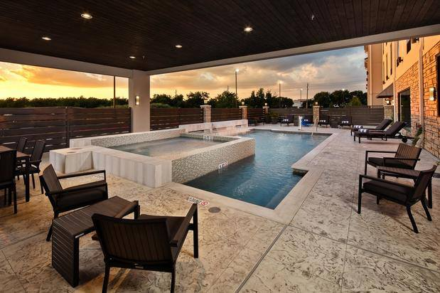 Outdoor Pool With Whirlpool & Cascading Waterfall 4 of 21