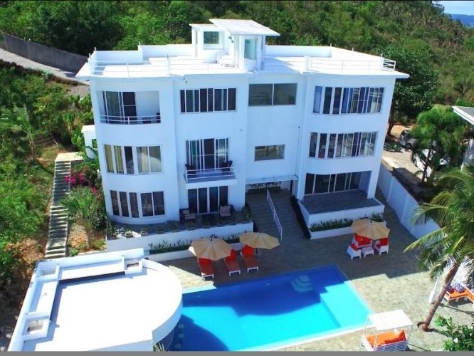 Aerial View Showing Swimming Pool And Roof Deck Area. 26 of 31