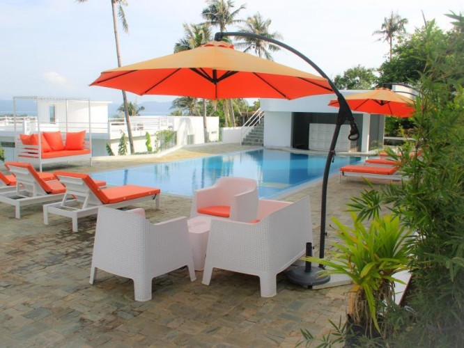 View Of The Pool Area Looking Towards The Pool Bar. 27 of 31