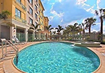 After Enjoying A Workout In Our Fitness Center Take A Dip In Our Outdoor Swimming Pool Beneath The Gorgeous Florida Sun. 4 of 7