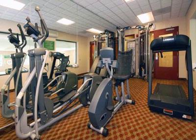 Exercise Room With Cardio Equipment And Weights 18 of 19