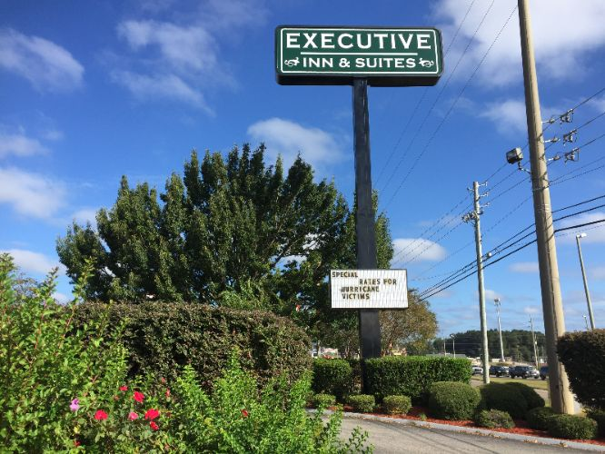 Executive Inn & Suites 1 of 8