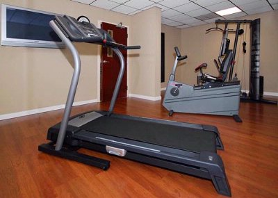 Exercise Room With Cardio Equipment And Weights 13 of 17