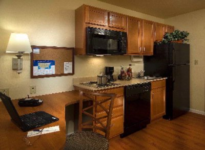 Every Room Has A Full Kitchen With All The Amenities 5 of 8