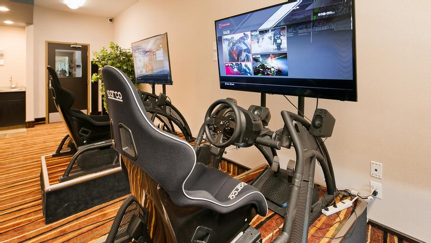 Challenge Your Boss Or Even Your Parents To A Head To Head Race In Our Race Car Simulators! Free To Our Guests! 6 of 11