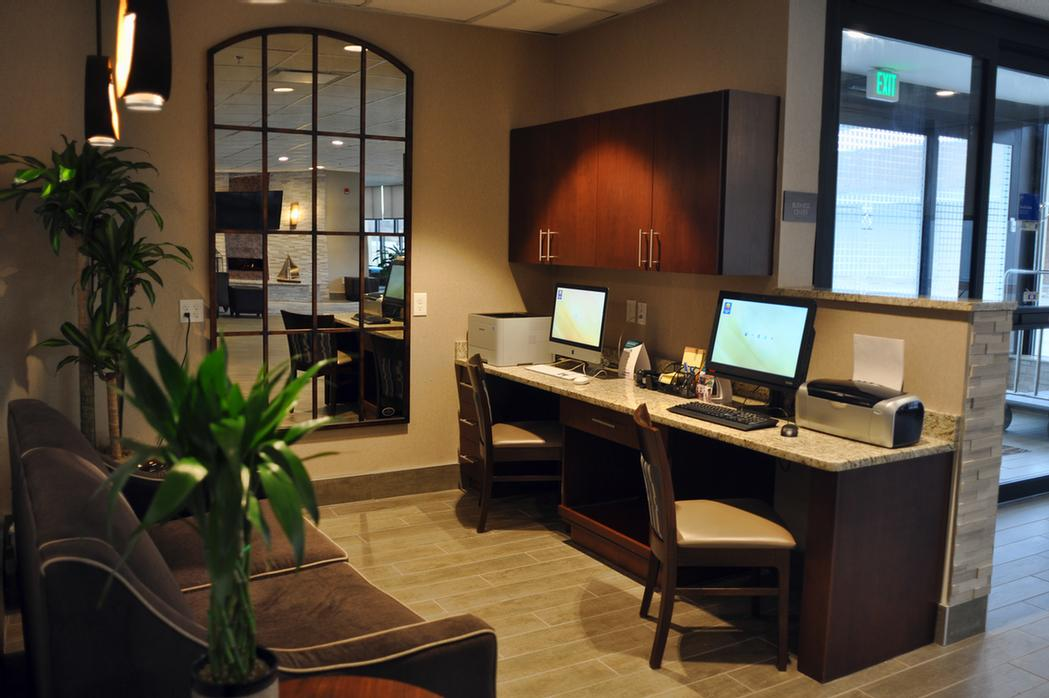 Business Center Available 24/7 Featuring Both A Mac And Pc Each With Its Own Printer 9 of 15