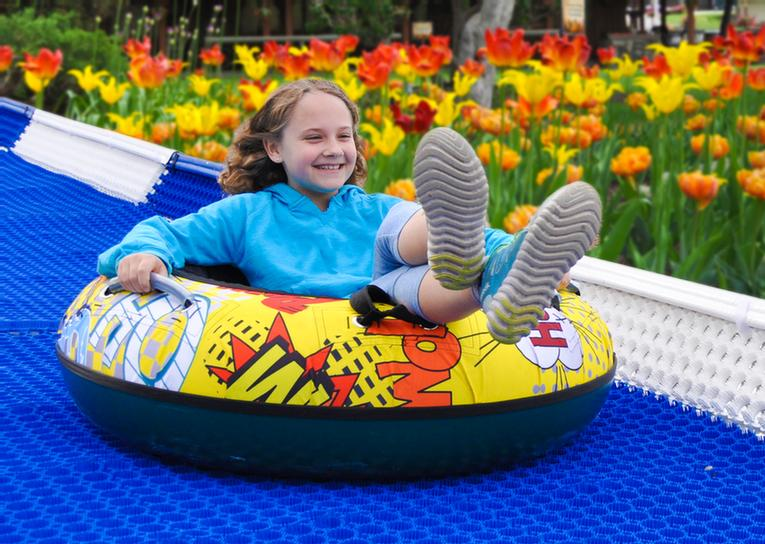 Northeast's Longest Mountain Tubing Adventure. The Fun Of Snow Tubing Is Now Year-Round! Ride Our Magic Carpet Lift To The Top Of The 'big Hill' Then Take The Plunge Down To Experience A Thrill The Whole Family Will Enjoy! 5 of 14