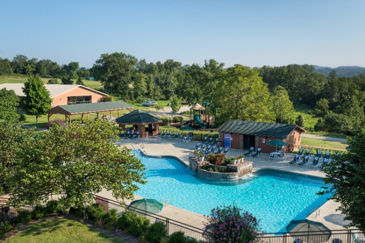 Main Outdoor Pool With Two Hot Tubs. Lighted Playground Is Located Direclty Behind The Pool. 3 of 16