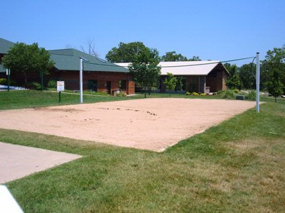 Play A Friendly Game Of Volleyball In The Sand Court! 8 of 16