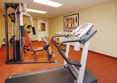 Exercise Room With Cardio Equipment And Weights 6 of 9