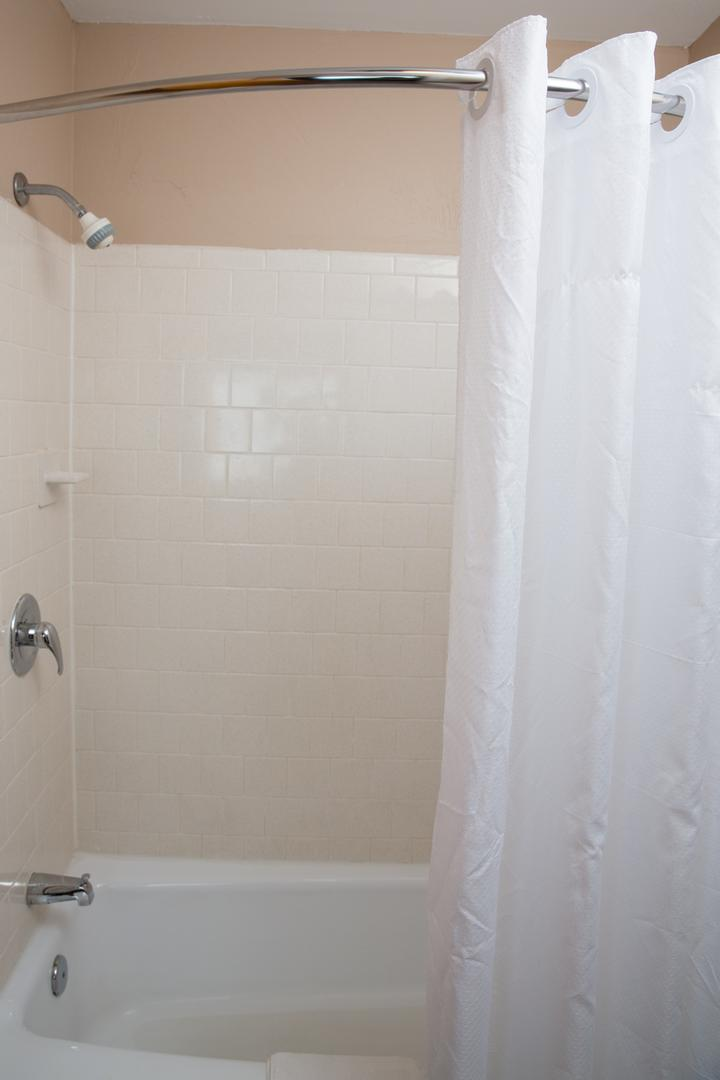 All Bathrooms Equipped With Bath Tub & Curved Shower Rods For More Room 13 of 13