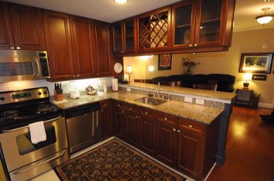 All Units Have Full Kitchen Furnished With Cookware And Dinnerware 9 of 31