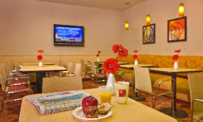 Enjoy A Complimentary Breakfast In Our Bright Breakfast Room. Works Well As A Team Room Also. 7 of 9