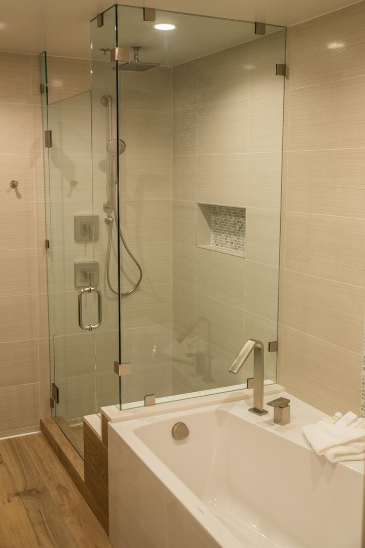 Junior Suite: Each One Of Our Newly Remolded Suites Has A Deep Set Tub And Glass Standing Shower. 9 of 17