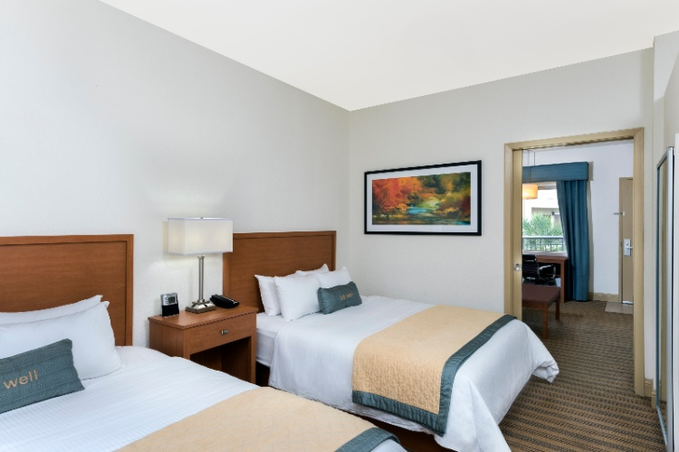 Our Two-Room Queen Suites Offer Two Queen Beds And A Queen Sized Pull Out Sofa Sleeper. 4 of 11