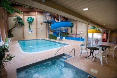 Enjoy An Evening In Our Wonderful Pool Area Featuring A 133\' Indoor Waterslide! 3 of 10