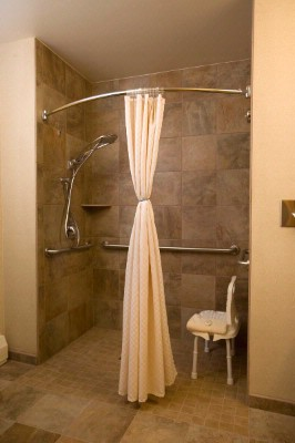 Tiled Walk In/roll In Shower For The Handi-Capped Accessible Room. 9 of 10