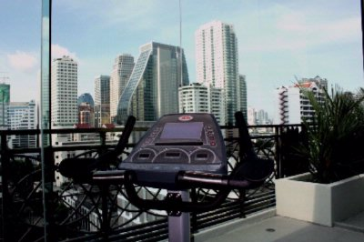 Rooftop Fitness Room With City View 4 of 11