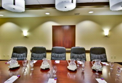 Executive Boardroom With Leather Chairs And Oval Table 14 of 25