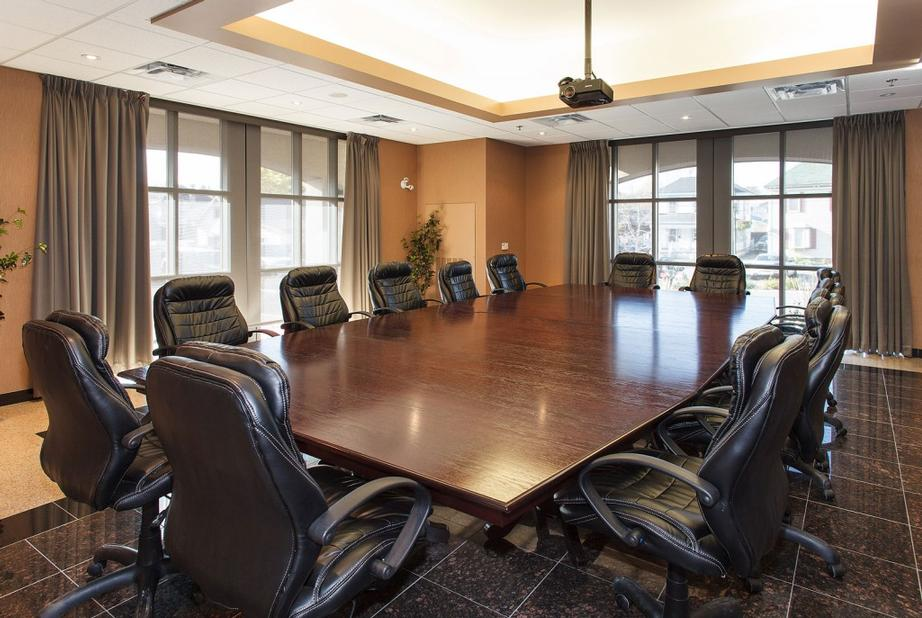 Our Board Room Seats Up To 20 People. This Room Is Equipped With Projector And Screen As Well As Telephone Conferencing Capabilities 7 of 11