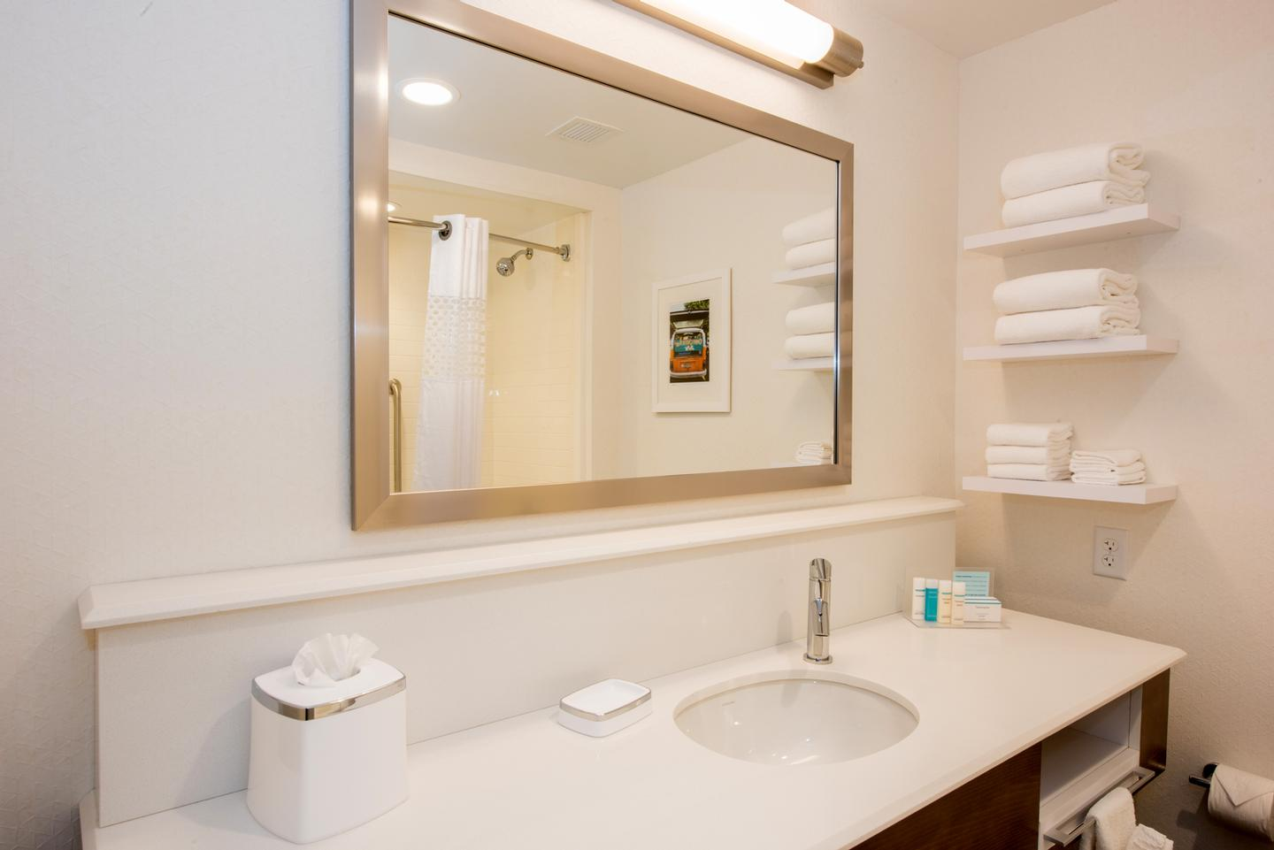 Bright White Bathrooms With Lot Of Counter Space 3 of 9