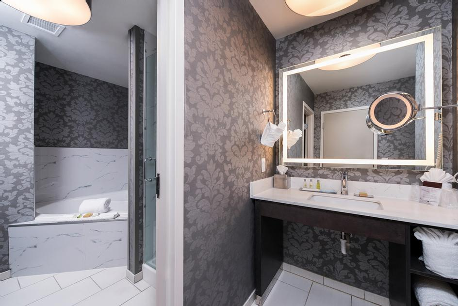 This Suite Has A Large Living Room Area With Pull Out Sofa And 49in Hdtv And Bathroom Includes A Shower And Whirlpool Tub For Two Adults 9 of 10