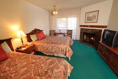 Two Queen Beds With Fireplace 3 of 19