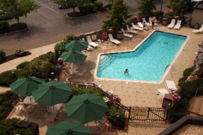 The Perfect Way To End Your Day Is In Our Outdoor Pool. Relax On Our Patio And Enjoy Your Time Away. 7 of 8