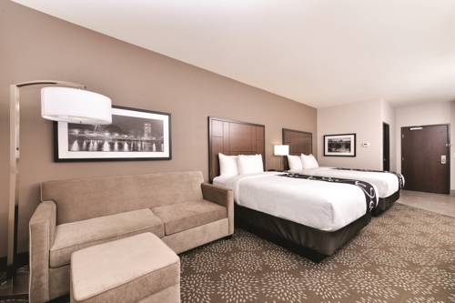 Feel Comfortable In Our Deluxe 2 Queen Room 7 of 11