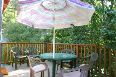 Private Deck With Umbrella Table & Chairs Which Looks Down On Backyard 11 of 13