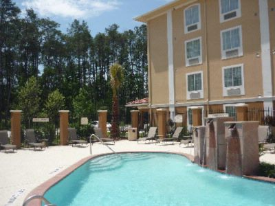 The Outdoor Heated Pool Is A Great Place To Relax And Unwind. 3 of 8