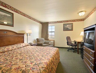 King Bedroom -Amenities: Microwave Refrigerator Tv Wireless Internet Hair Dryer Iron + Iron Board Free Local Calls Coffee Maker 4 of 10