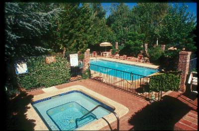 Enjoy Our Heated Pool And Jacuzzi 5 of 8