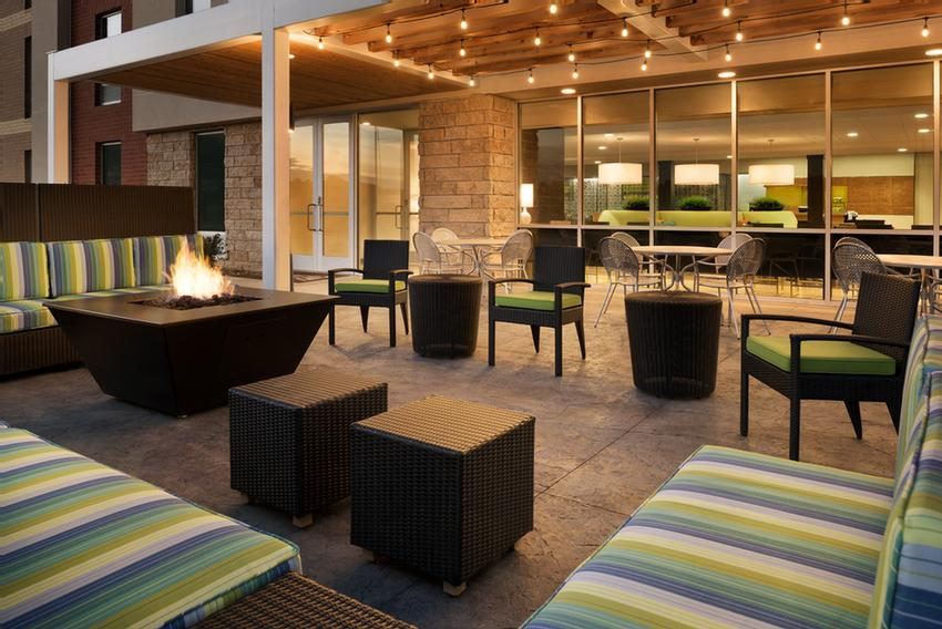 Relax And Unwind Inside Our Lobby Or Outdoors With A Fire Pit And Grills 4 of 6