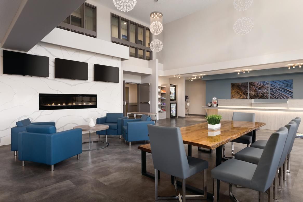 Gather With Friends At The Cozy Fireplace Or Our Living Edge Lobby Table. 3 of 11