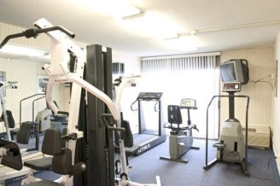 Fitness Center Features Weightstation And Treadmills 6 of 8